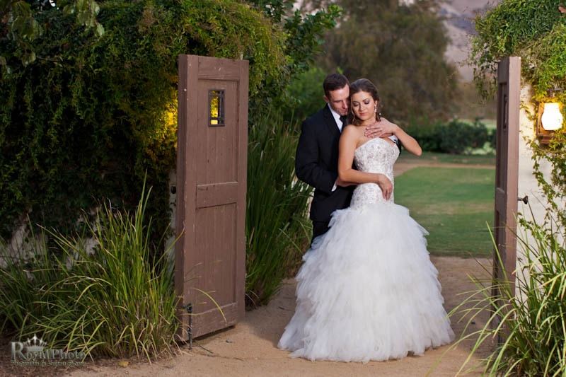 Romantic newlyweds outdoor portrait
