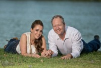 Engagement photography  on the ground in the grass